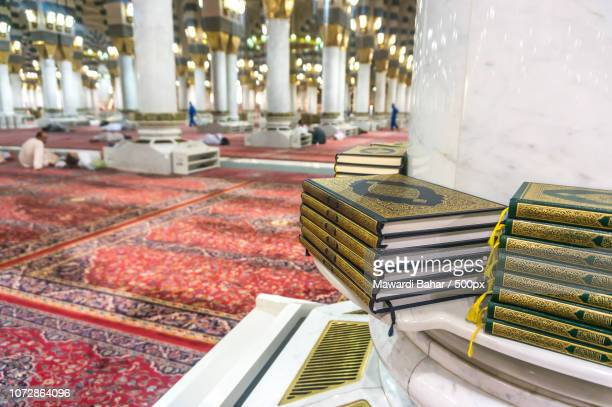MEDINA-MAR 08 : A stack of Quran inside of Masjid Nabawi March 08, 2015 in Medina, Saudi Arabia. Nab