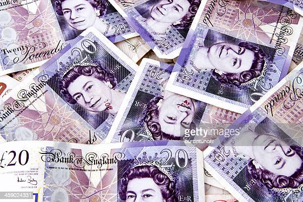 stack of random 20 british pound notes - twenty pound note stock photos and pictures
