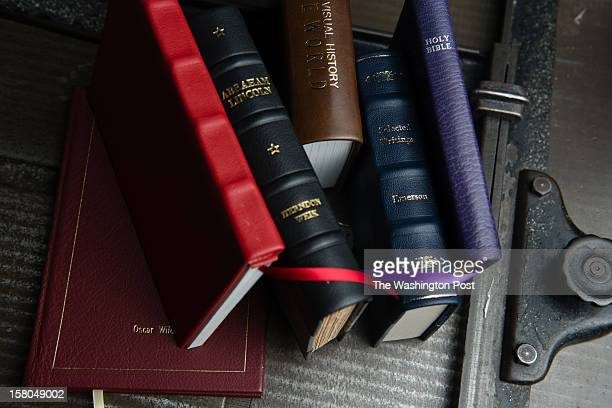 A stack of rebound books are pictured Distinctive Bookbinding is a small company that does very specialized work with books and leather goods such as...