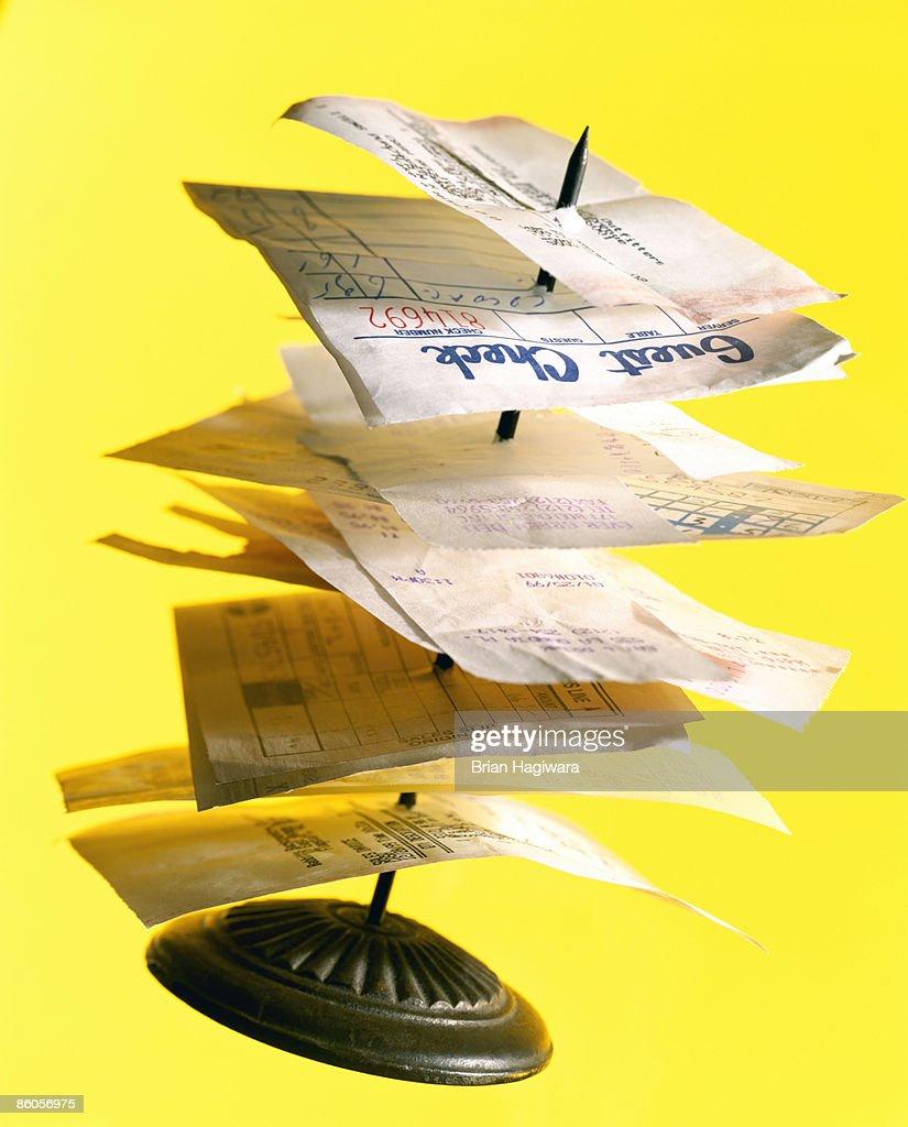 Stack of receipts on restaurant spike : Foto de stock