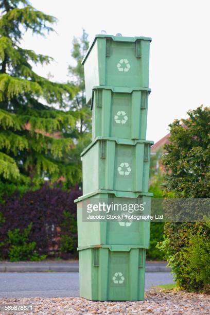 Stack of recycling bins near street