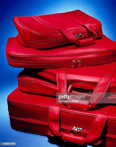 Stack of red luggage