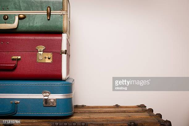 Stack of Retro Suitcases, Sitting on Wood, With Copy Space