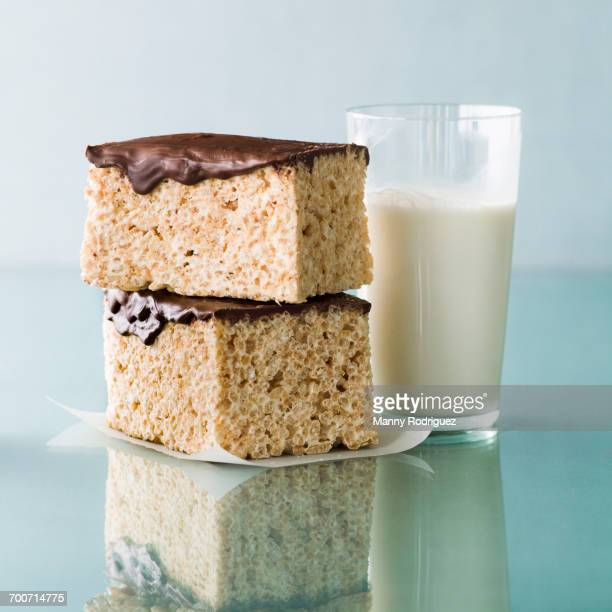 Stack of rice cakes with chocolate icing and milk