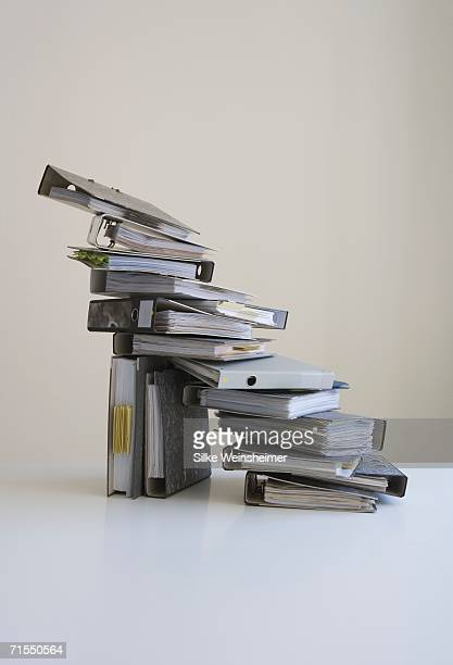 Stack of ring binders on table