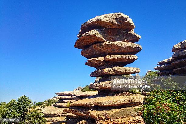 Stack Of Rocks Against Clear Blue Sky