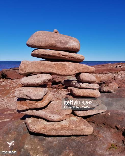 stack of rocks against clear blue sky - sibley stock photos and pictures