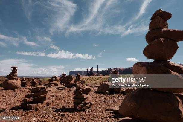 stack of rocks on landscape against cloudy sky - christian soldatke stock pictures, royalty-free photos & images