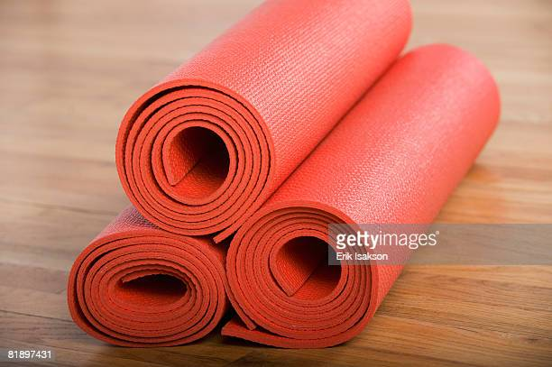 Stack of rolled yoga mats