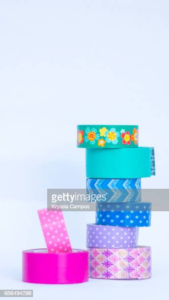 Stack of Rolls of decorative sticky tape for crafts