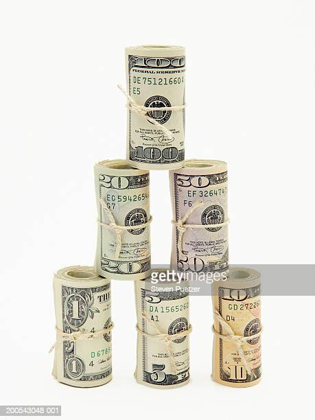 Stack of rolls of USA banknotes of various denominations