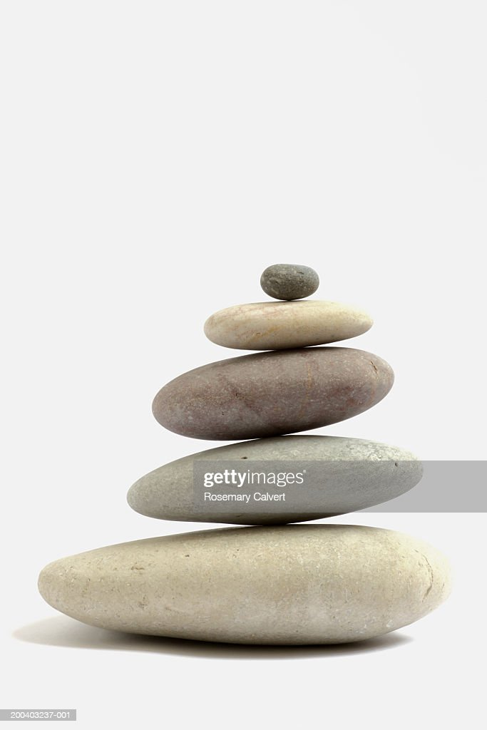 Stack of rounded pebbles, side view : Stock Photo