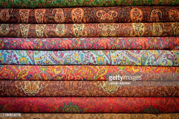stack of rugs - cachemire motif photos et images de collection