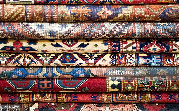 stack of rugs - persian rug stock photos and pictures