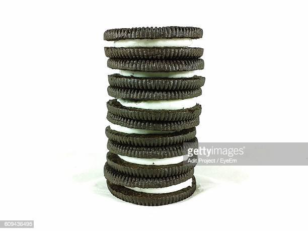 Stack Of Sandwich Cookies Against White Background