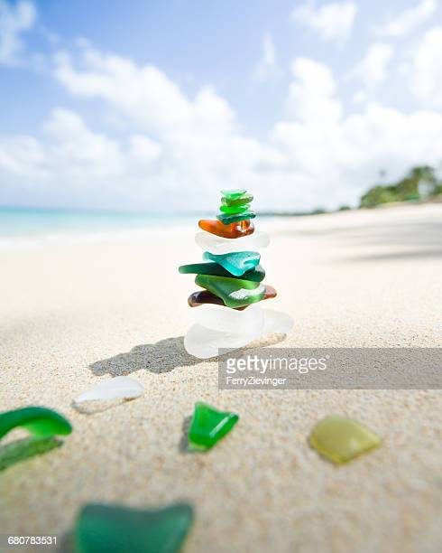 Stack of sea glass on beach, Barbados, Caribbean