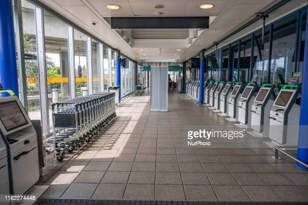 Stack of Self Checkin kiosks Interior of London City Airport LCY EGLC located in the Royal Docks in Borough of Newham Silvertown near the City of...