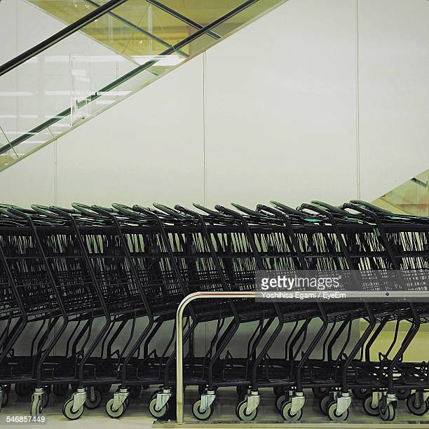 Stack Of Shopping Carts In Supermarket