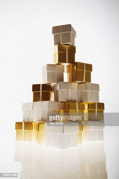 Stack of small gold and white gift boxes