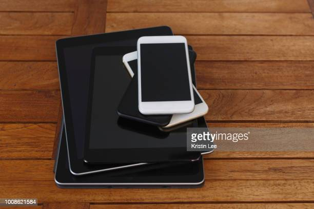 Stack of smart phones and digital tablets