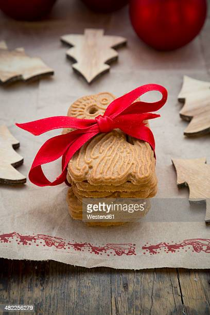 Stack of spiced cookies tied up with red ribbon