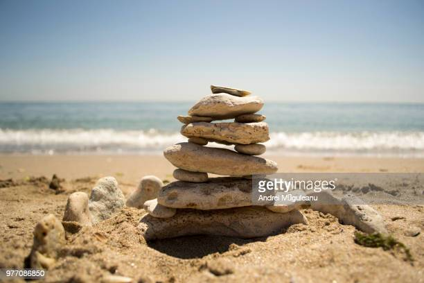 Stack of stones on sandy beach, Costinesti, Romania