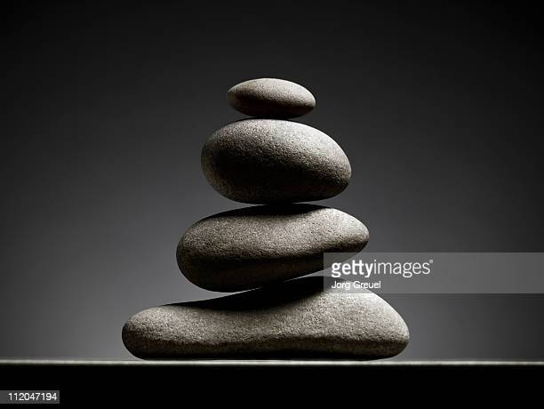 a stack of stones - pebble stock photos and pictures