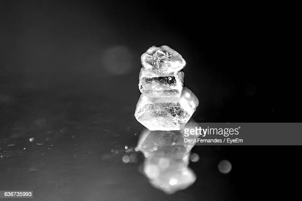 Stack Of Sugar Crystals On Glass Table