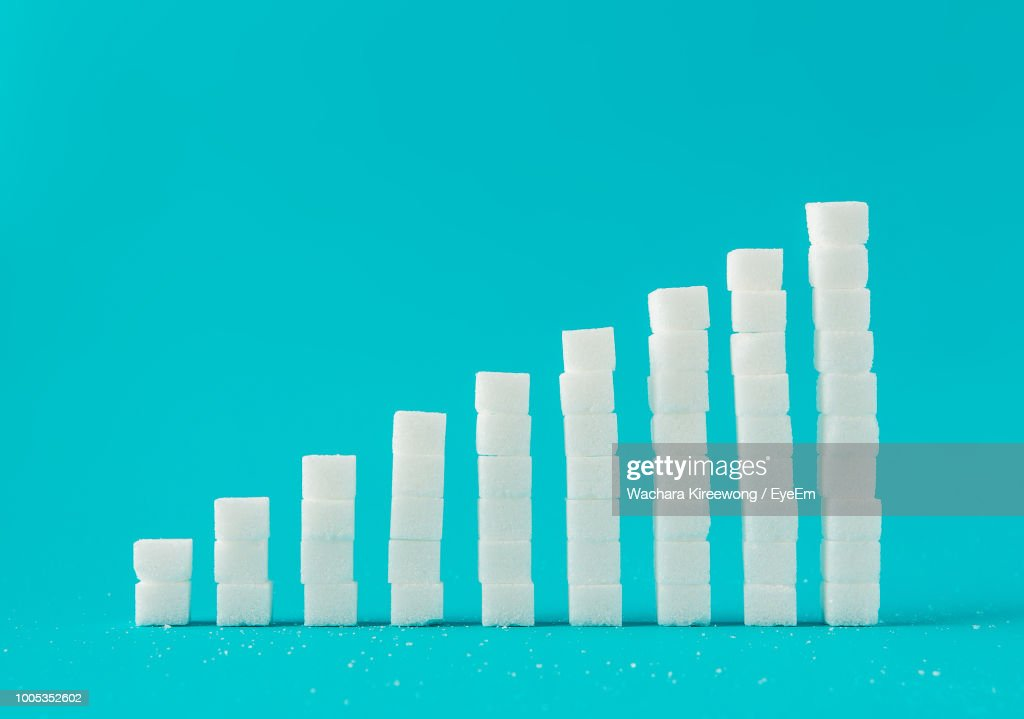 Stack Of Sugar Cubes Against Blue Background : Stock Photo