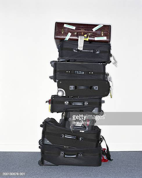 Stack of suitcases one labelled 'fragile'