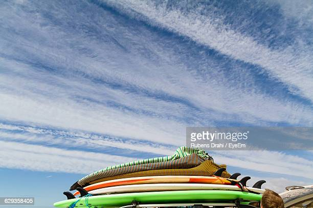stack of surfboards against cloudy sky - agadir stock pictures, royalty-free photos & images