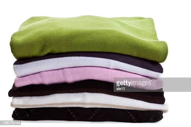 stack of sweaters - top garment stock pictures, royalty-free photos & images