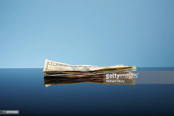 stack of ten dollar bills - richard drury stock pictures, royalty-free photos & images