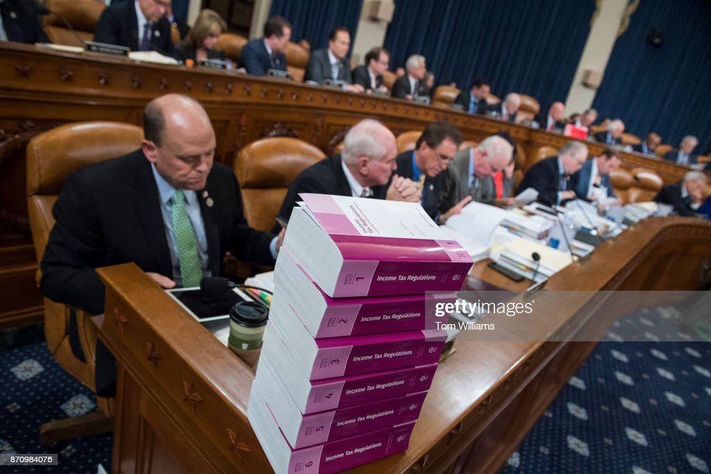 A Stack Of The Current Income Tax Regulations Sits On The Dais During A  House Ways