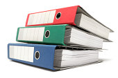 Stack of Three Colored Ring Binders