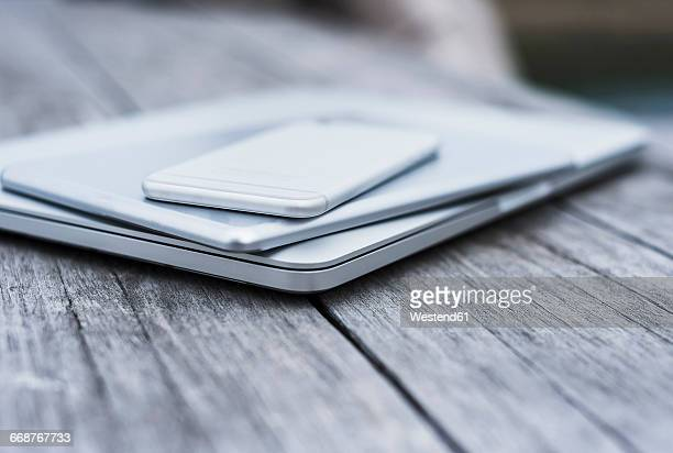 Stack of three mobile devices