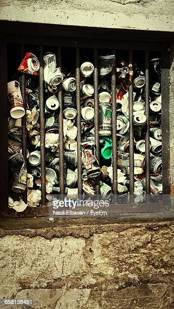 Stack Of Tin Cans Against Window