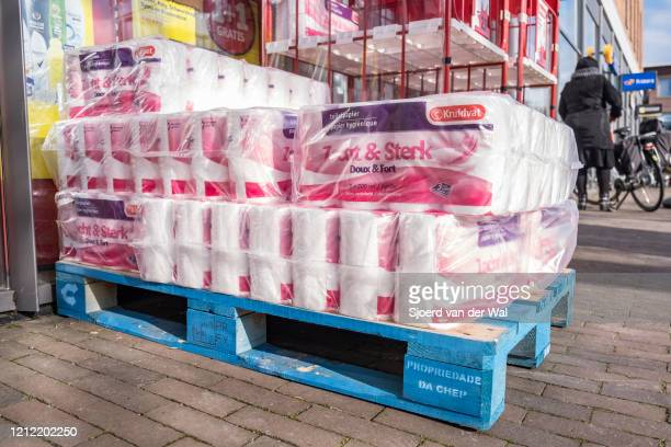Stack of toilet paper in front of a drug store in Kampen after the announcement by the government of new measures for prevention of the spread of the...