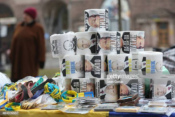 A stack of toilet paper with the face of Russian President Vladimir Putin printed on them stands for sale at an outdoor kiosk on February 21 2015 in...