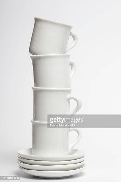 A stack of toy teacups and saucers