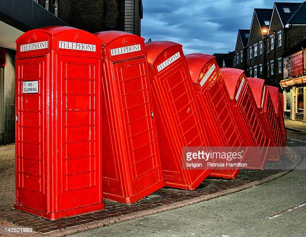 stack of tumbling telephone boxes - kingston upon thames stock pictures, royalty-free photos & images