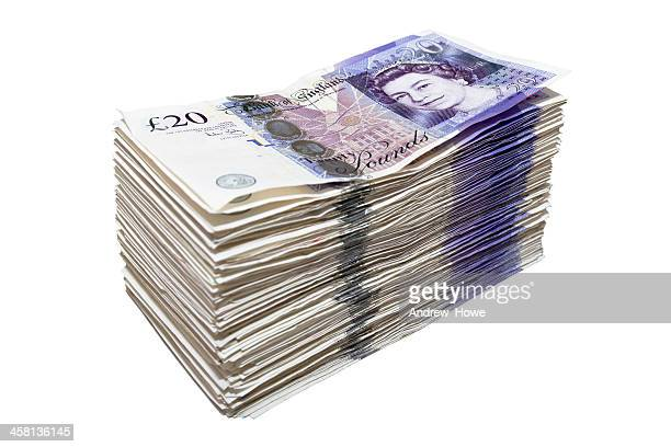 stack of twenty pound notes - british pound sterling note stock pictures, royalty-free photos & images
