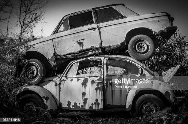 stack of two car wrecks - peter lourenco stock pictures, royalty-free photos & images