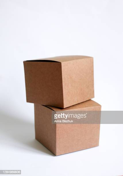 stack of two cardboard boxes against white background, vertical picture - cardboard box stock pictures, royalty-free photos & images