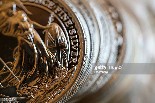 A stack of UK one ounce silver coins are seen in this arranged photograph at Gold Investments Ltd bullion dealers in London UK on Thursday Nov 1 2012...