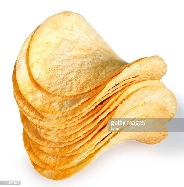 Stack of uniformly baked potato chips on a white background