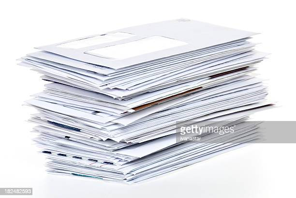 stack of unpaid bills and envelopes isolated on white - financial bill stock pictures, royalty-free photos & images