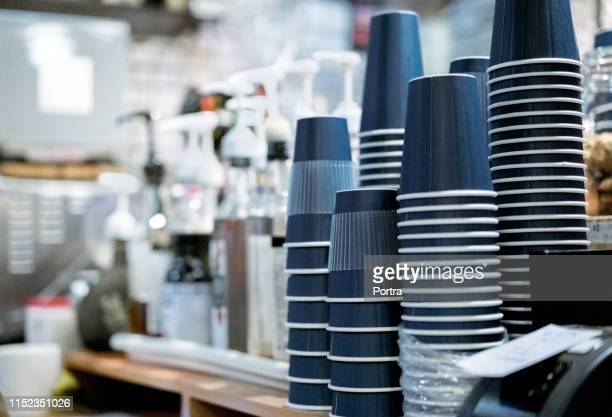 stack of upside down disposable cups at cafe - disposable cup stock pictures, royalty-free photos & images