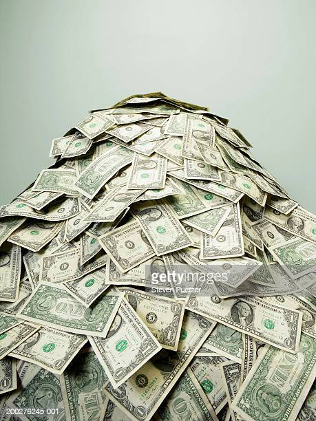 stack of us paper currency - heap stock pictures, royalty-free photos & images