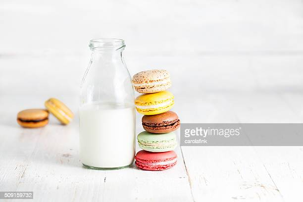 Stack of varied mixture of macaroons with milk can